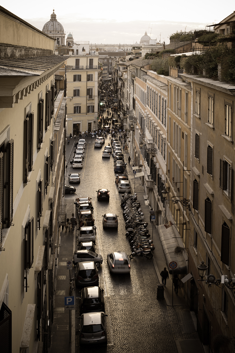 Gazing up a narrow street from the Spanish Steps to St. Peters Basilica