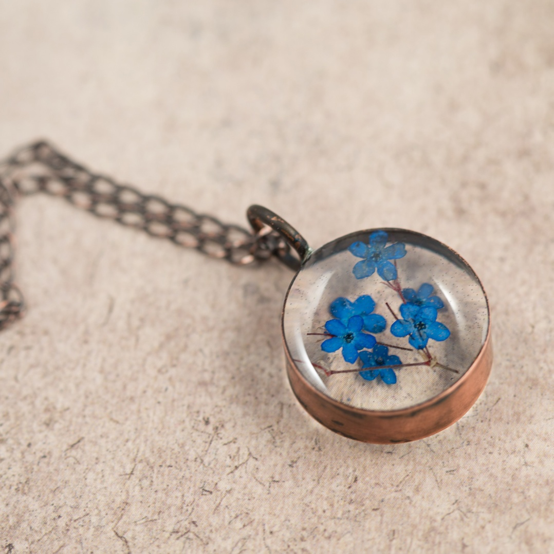 $65 - Real Forget-Me-Nots, preserved in a handmade copper bezel.