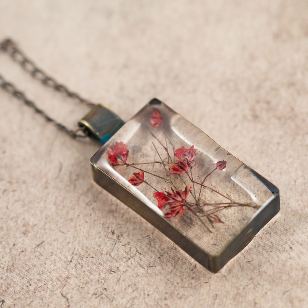 $65 - Real Baby's Breath, preserved in a handmade brass bezel.