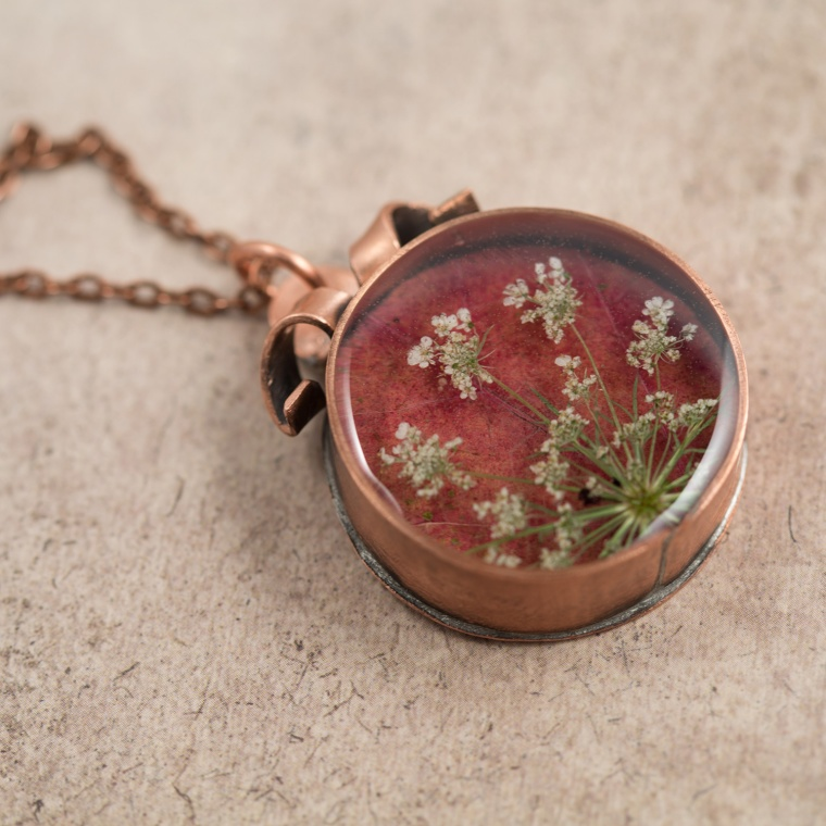 $85 - Real Queen Anne's lace and Maple leaf, preserved in a handmade copper bezel.
